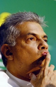 Opposition leader Ranil Wickramasinghe listens to journalists during a National Council coalition party news conference in Colombo